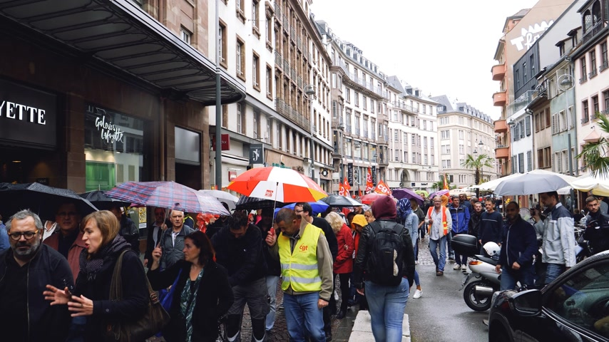 lafayette : STRASBOURG, FRANCE - SEP 12, 2018: Marching near Galleries Lafayette at French Nationwide day of protest against labor reform proposed by Emmanuel Macron Government