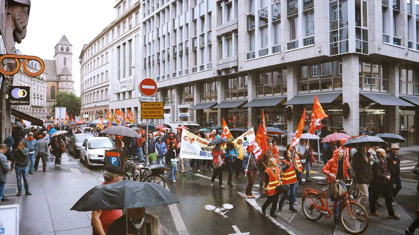 nationwide : STRASBOURG, FRANCE - SEP 12, 2018: Crowds with CGT flags marching peacefully at French Nationwide day of protest against labor reform proposed by Emmanuel Macron Government