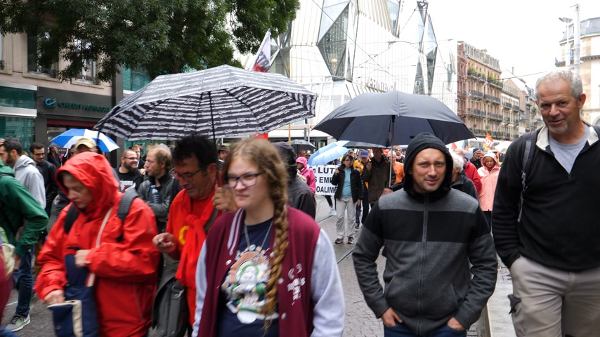 nationwide protest : STRASBOURG, FRANCE - SEP 12, 2018: Walking people with placards at French Nationwide day of protest against labor reform proposed by Emmanuel Macron Government