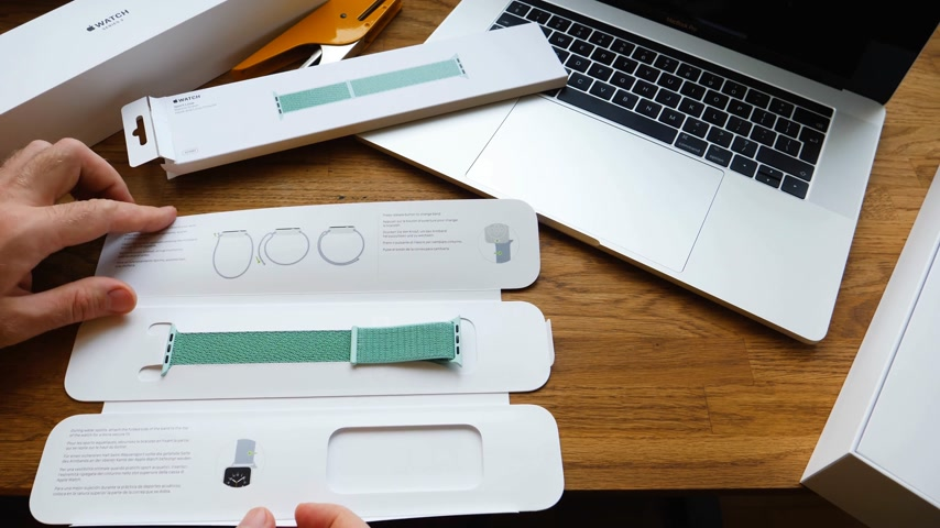 wristband : PARIS, FRANCE - APR 24, 2018: New Apple Watch Series 3 smartwatch change strap to the new 42mm Marine Green Sport Loop  - admiring the strap