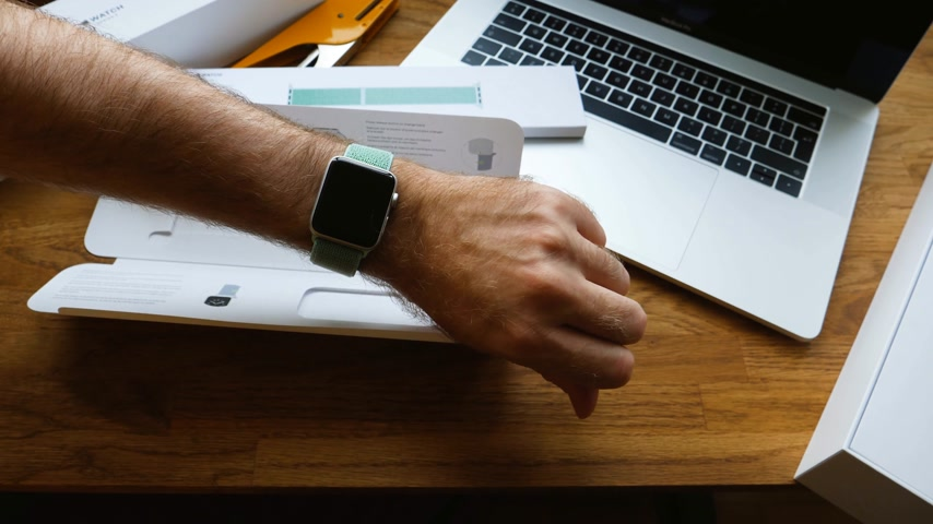 wristband : PARIS, FRANCE - APR 24, 2018: New Apple Watch Series 3 smartwatch change strap to the new 42mm Marine Green Sport Loop - testing the new strap band Stock Footage