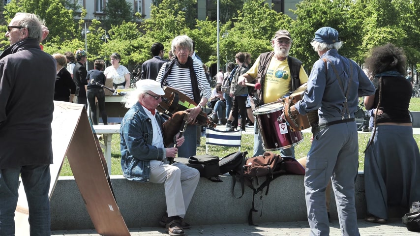 fete : STRASBOURG, FRANCE - MAY 5, 2018: People making a party protest Fete a Macron in front of Gare de Strasbourg - music orchestra playing entertainment
