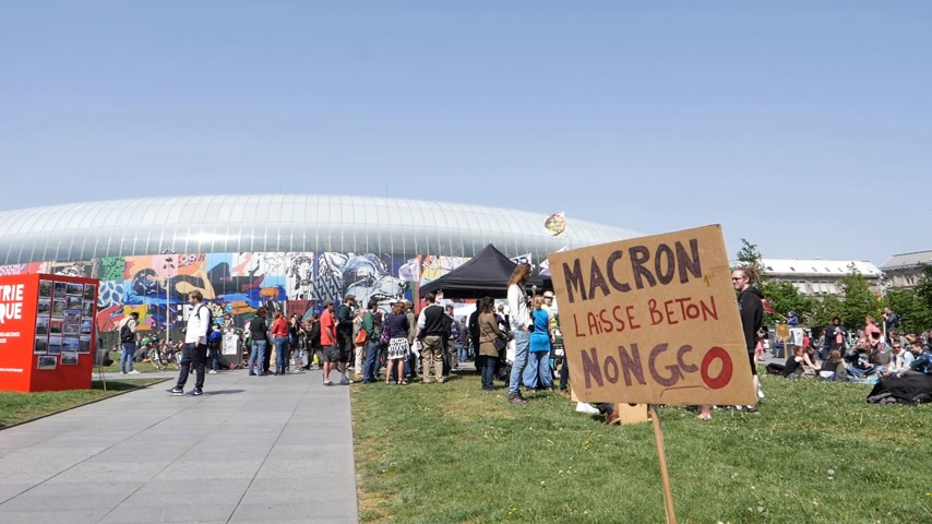 activist : STRASBOURG, FRANCE - MAY 5, 2018: People making a party protest Fete a Macron party for Macron in front of Gare de Strasbourg against grand contournement ouest de Strasbourg slow motion