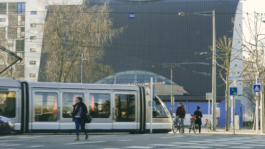 despesas gerais : STRASBOURG, FRANCE - CIRCA 2018: Gas Station Total Access Station in urban city environment with city commuters, tramway and cars