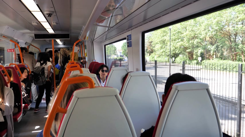 windsor : WINDSOR, BERKSHIRE, UNITED KINGDOM - MAY 19, 2018: British train interior arriving at Windsor Eaton Riverside for royal wedding marriage of Prince Harry and Meghan Markle Stock Footage