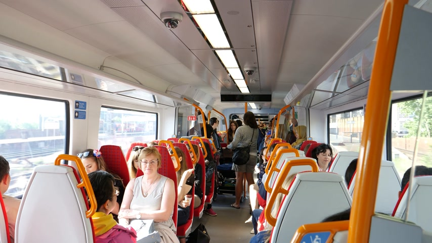 vezető : WINDSOR, BERKSHIRE, UNITED KINGDOM - MAY 19, 2018: British train interior with destination Windsor Eaton Riverside for royal wedding marriage of Prince Harry and Meghan Markle time-lapse Stock mozgókép