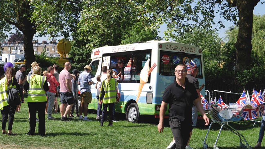 cinematic : WINDSOR, UNITED KINGDOM - MAY 19, 2018: Queue at the Ice Cream van in Long Road Park at royal wedding marriage celebration of Prince Harry and  Meghan Markle