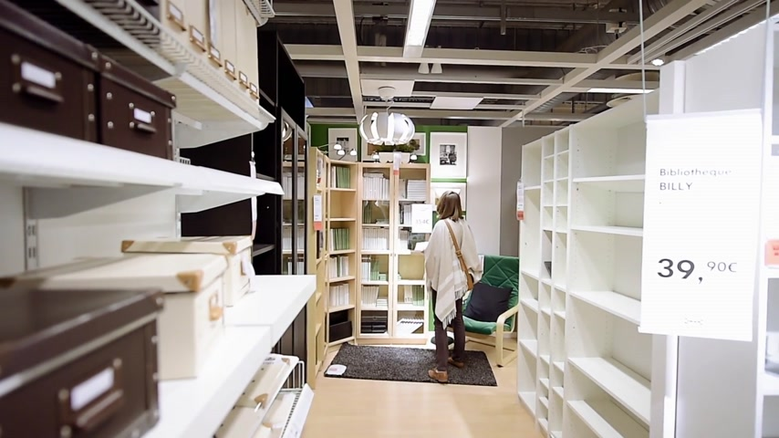 shelf life : PARIS, FRANCE - CIRCA 2018: Modern IKEA furniture store with woman customer buying library furniture and decoration warehouse goods
