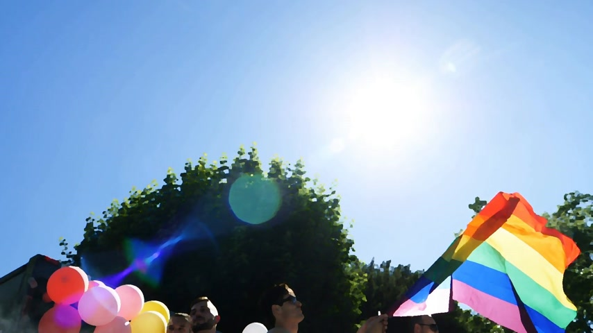 minority group : STRASBOURG, FRANCE - JUN 10, 2017: Cartoon effect of group excited friends gay people supporters dancing with rainbow flag in slow motion at LGBT GLBT visibility march pride FestiGays