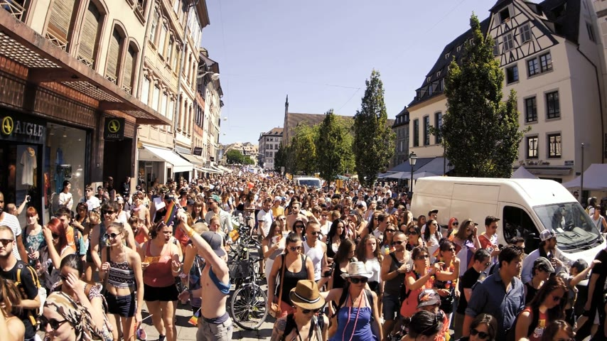 haklar : STRASBOURG, FRANCE - JUN 10, 2017: High angle of French street with thousands of people jumping dancing gay supporters dancing with rainbow flag at Lesbian Gay LGBT GLBT visibility march pride Stok Video