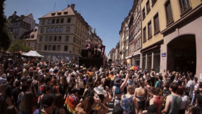 minority group : FRANCE - JUN 10, 2017: VHS effect over French street thousands people jumping dancing gay supporters with rainbow flag slow motion Lesbian Gay Bisexual Transgender LGBT GLBT visibility march pride