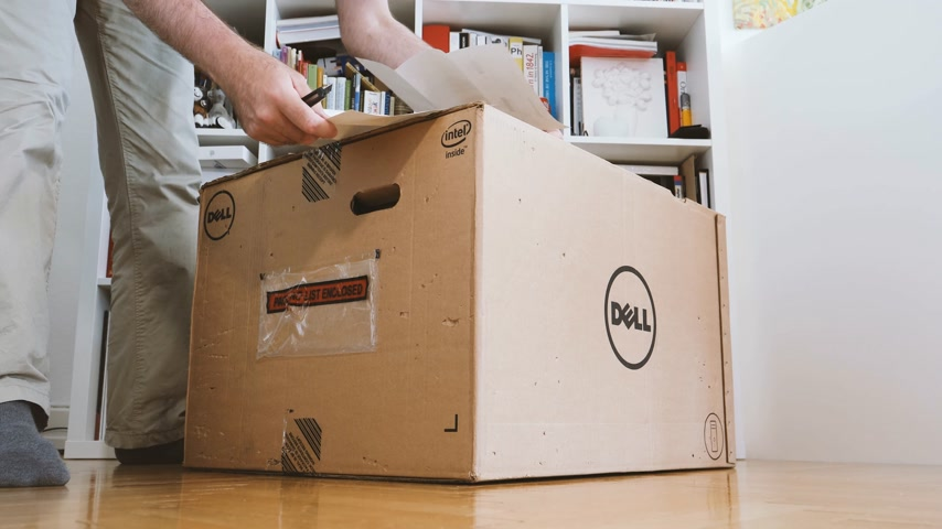 intel : LONDON, UNITED KINGDOM - CIRCA 2017: Man inspecting packaging list of Dell Workstation Server Dell Precision T7920 7910 in living room
