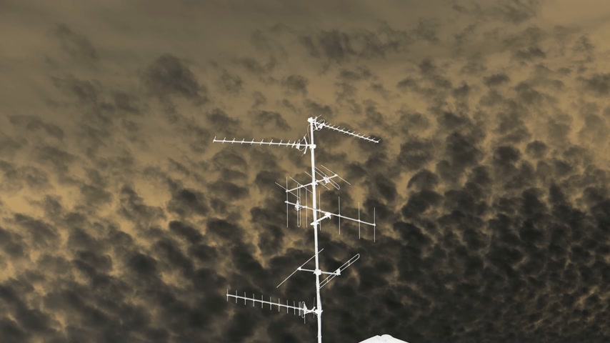 inverted : Black sky majestic cirrocumulus clouds on a summer afternoon with TV Television aerial antenna in the middle of the frame in 4k UHD cinematic mode Stock Footage
