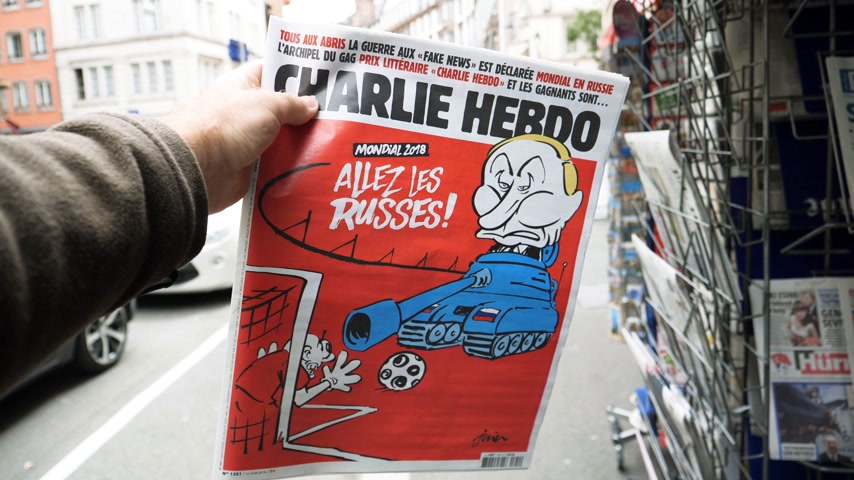 caricatura : PARIS, FRANCE - CIRCA 2018: Russian President Vladimir Putin caricature on Charlie Hebdo cover - sitting in a tank and yelling Go Russians Stock Footage