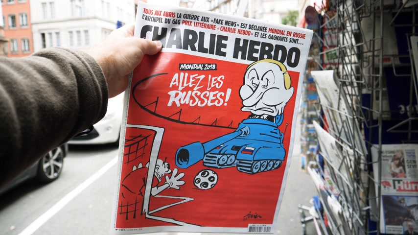 caricatura : PARIS, FRANCE - CIRCA 2018: Slow motion POV at Russian President Vladimir Putin caricature on Charlie Hebdo cover - sitting in a tank and yelling Go Russians
