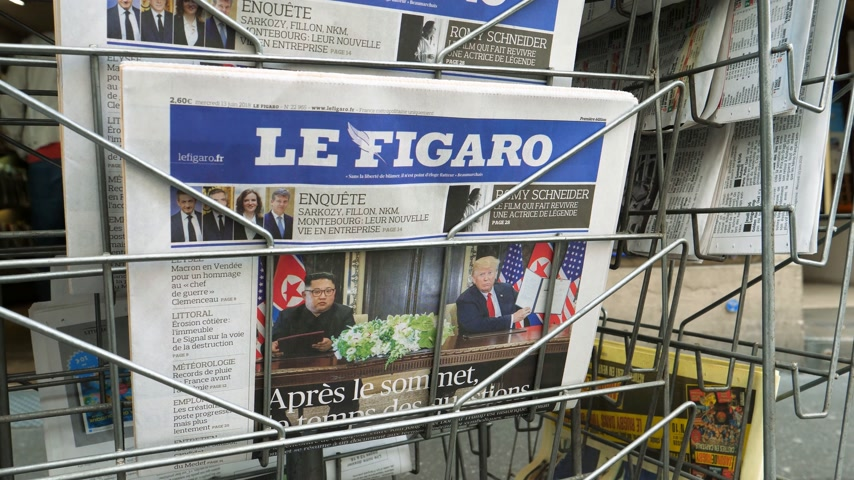 french president : PARIS, FRANCE - JUNE 13, 2018: Le Figaro newspaper at press kiosk showing on cover  U.S. President Donald Trump meeting North Korean leader Kim Jong-un in Singapore
