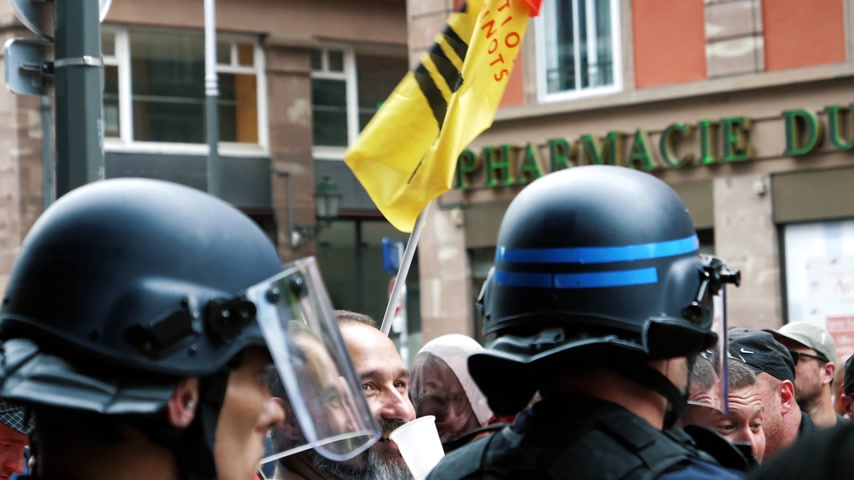 syndicate : STRASBOURG, FRANCE - JUN 20, 2018: Police force protecting building from SNCF French train worker demonstration strike protest against Macron French government string of reforms