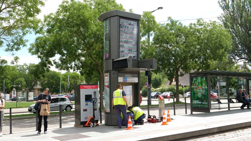 ticket machine : STRASBOURG, FRANCE - CIRCA 2018: Public transportation improvement - Installation by professional team of workers of the new ticket vending machine in tramway station Wacken in Strasbourg