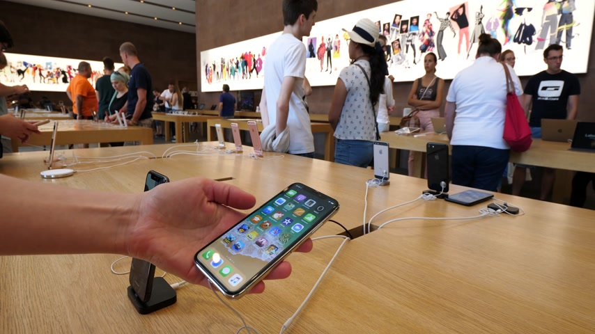 face id : PARIS, FRANCE - CIRCA 2018: Woman using in Apple store the latest new Apple iPhone X 10 smartphone