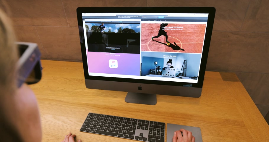apple workstation : STRASBOURG, FRANCE - CIRCA 2018: Visiting applke.com website on the new iMac Pro the all-in-one personal computer in Apple Computers Store woman pov working Stock Footage