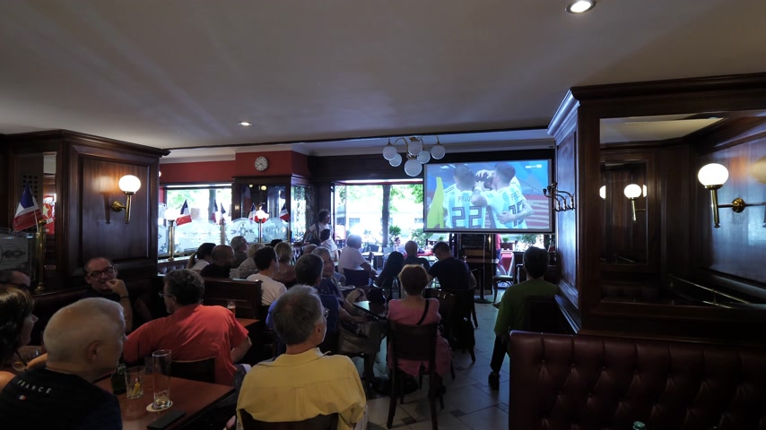 fan zone : STRASBOURG, FRANCE - JUN 30, 2018: Time lapse fast motion people watching World Cup 2018 soccer football in bar cafe in France during the game France Argentina score