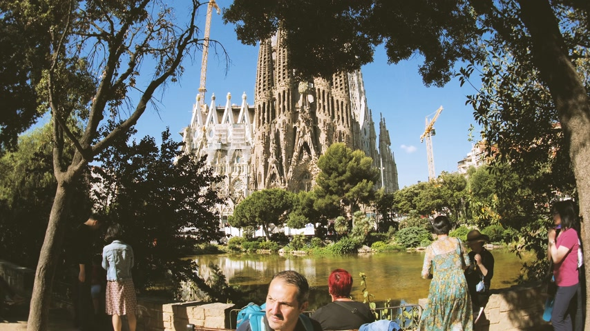 establishment : BARCELONA, SPAIN - CIRCA 2018: Tourist admiring Sagrada Familia Church built by Antoni Gaudi - international tourists taking photos selfies with the magnificent religious architecture from the Place de Gaudi