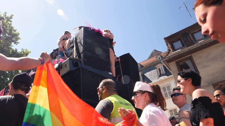 minority group : STRASBOURG, FRANCE - JUN 10, 2017: Slow motion group excited friends people supporters dancing with rainbow flag in slow motion at LGBT GLBT visibility march pride