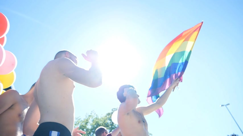 minority group : STRASBOURG, FRANCE - JUN 10, 2017: Cinematic people dancing at pride in France - low angle