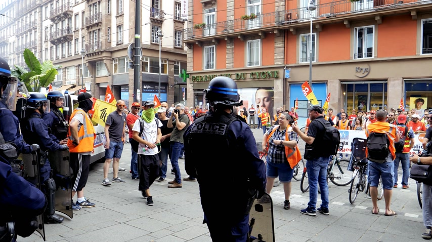 syndicate : STRASBOURG, FRANCE - JUN 20, 2018: Police officers with helmets protecting the city from SNCF French train worker demonstration strike protest against Macron French government string of reforms