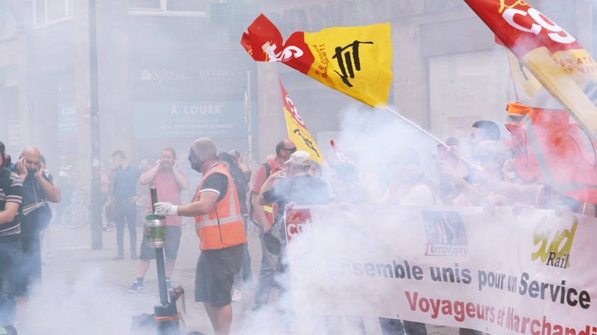 syndicate : STRASBOURG, FRANCE - JUN 20, 2018: Smoke and noise grenade by SNCF French train worker demonstration strike protest against Macron French government string of reforms