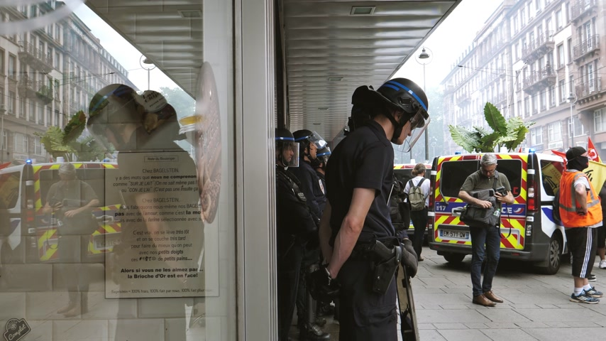 nationwide : STRASBOURG, FRANCE - JUN 20, 2018: Police group surveillance of SNCF French train worker at demonstration strike protest against Macron French government string of reforms - smoke grenade