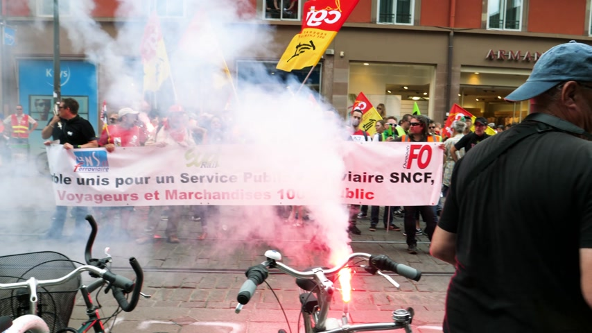 syndicate : STRASBOURG, FRANCE - JUN 20, 2018: Smoke grenade and flares SNCF French train worker demonstration strike protest against Macron French government string of reforms