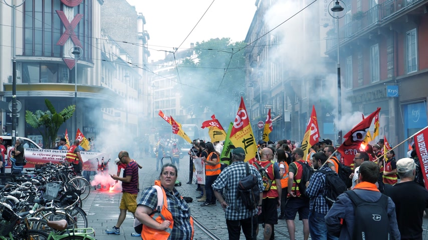 emmanuel macron : STRASBOURG, FRANCE - JUN 20, 2018: Closed central street by SNCF French train workers demonstration strike protest with smoke grenades and flares