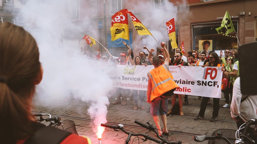 syndicate : STRASBOURG, FRANCE - JUN 20, 2018: Man jumping in front of SNCF French train worker demonstration strike protest against Macron French government string of reforms flares noise, slow motion Stock Footage