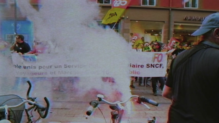 nationwide protest : STRASBOURG, FRANCE - JUN 20, 2018: Vintage VHS effect over SNCF French train worker demonstration strike protest against Macron French government string of reforms Stock Footage