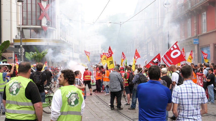 syndicate : STRASBOURG, FRANCE - JUN 20, 2018: Large protest of SNCF French train worker demonstration strike protest against Macron French government string of reforms - smoke grenades flares