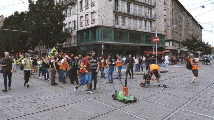 syndicate : STRASBOURG, FRANCE - JUN 20, 2018: Handheld video of SNCF French train worker demonstration strike protest in central Strasbourg, preparing to explode a noise smoke grenade Stock Footage