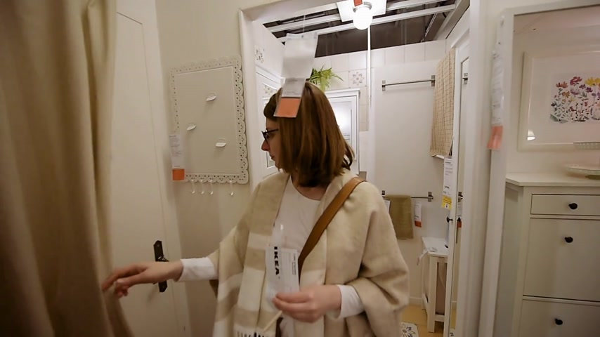 showcase : PARIS, FRANCE - CIRCA 2018: Fast motion time lapse of elegant woman in modern IKEA furniture store with woman customer browsing through diverse bathroom kitchen furniture, decoration warehouse goods