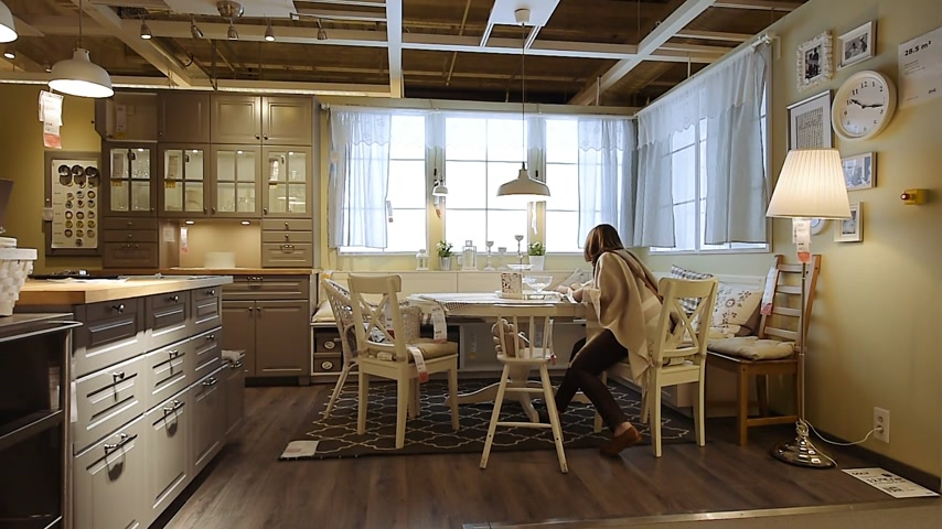 ikea : PARIS, FRANCE - CIRCA 2018: Woman with measuring tape inside modern new kitchen from Ikea measuring table Stock Footage