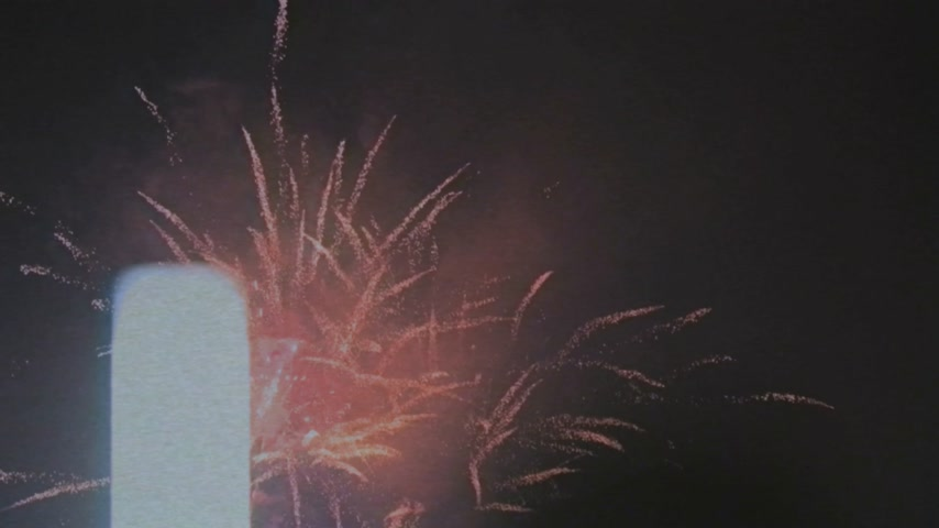 firecracker : Cinematic handheld vintage VHS footage of fireworks display during national day holiday Stock Footage