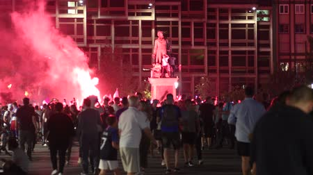 qualification round : STRASBOURG, FRANCE - JULY 10, 2018: Red smoke grenade Central Place Kleber after the victory of France qualify for the final of the 2018 FIFA World Cup
