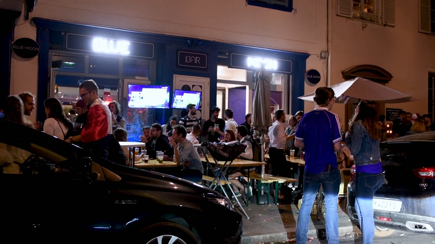 qualification round : STRASBOURG, FRANCE - JULY 10, 2018: Happy ambiance at French bar cafe after the victory of France qualify for the final of the 2018 FIFA World Cup after their victory over Belgium 1-0