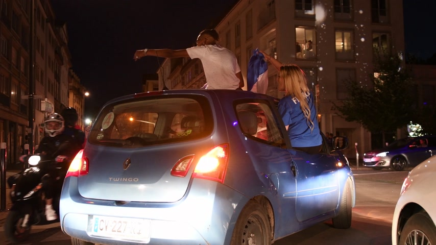 qualification round : STRASBOURG, FRANCE - JULY 10, 2018: Happy girl in a car waving French flag after victory of France qualify for the final of the 2018 FIFA World Cup after their victory over Belgium 1-0