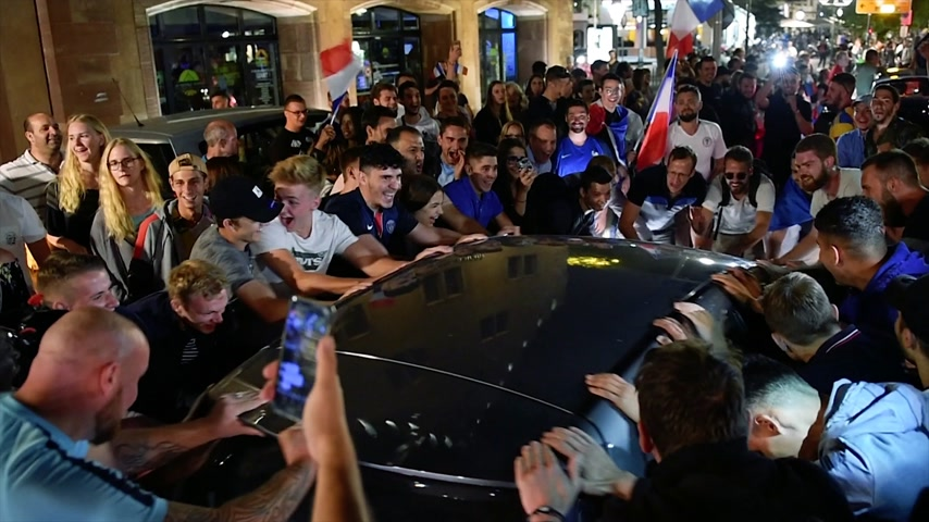 qualification round : STRASBOURG, FRANCE - JULY 10, 2018: Above view of French fans erupt with joy shaking cars in central Strasbourg - France wins its semi-final World Cup match against Belgium