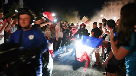 qualification round : STRASBOURG, FRANCE - JULY 10, 2018: Fans on motorcycles and mopeds after the victory of France qualify for the final of the 2018 FIFA World Cup after their victory over Belgium 1-0 Stock Footage