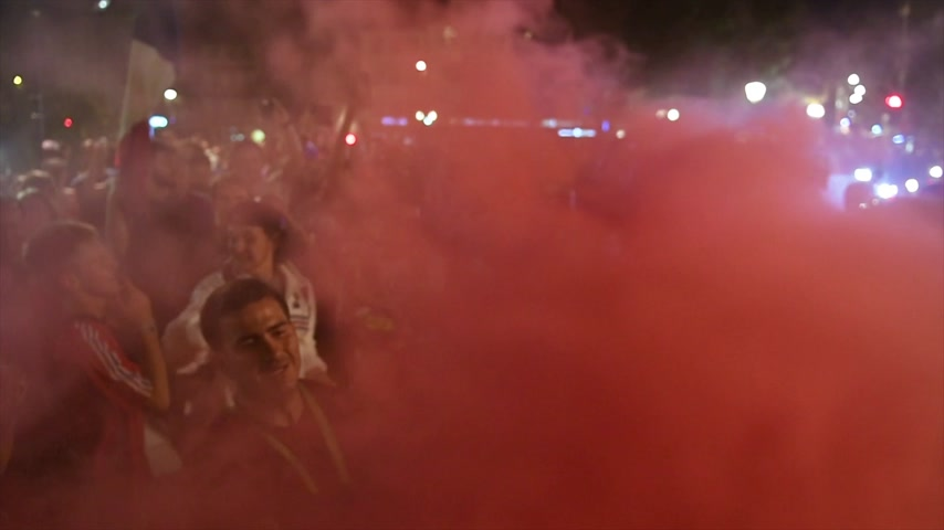 qualification round : STRASBOURG, FRANCE - JULY 10, 2018: Red smoke grenade supporters celebrating after the victory of France qualify for the final of the 2018 FIFA World Cup after their victory over Belgium 1-0 Stock Footage