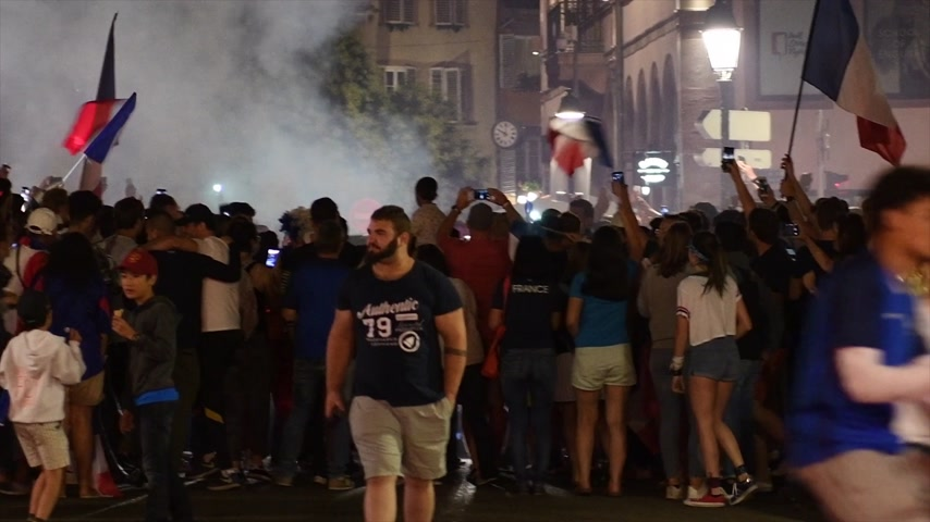 qualification round : STRASBOURG, FRANCE - JULY 10, 2018: Group of fans jumping dancing after the victory of France qualify for the final of the 2018 FIFA World Cup after their victory over Belgium 1-0