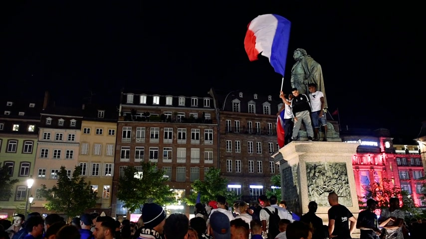 qualification round : STRASBOURG, FRANCE - JULY 10, 2018: Central crowd after the victory of France qualify for the final of the 2018 FIFA World Cup after their victory over Belgium 1-0