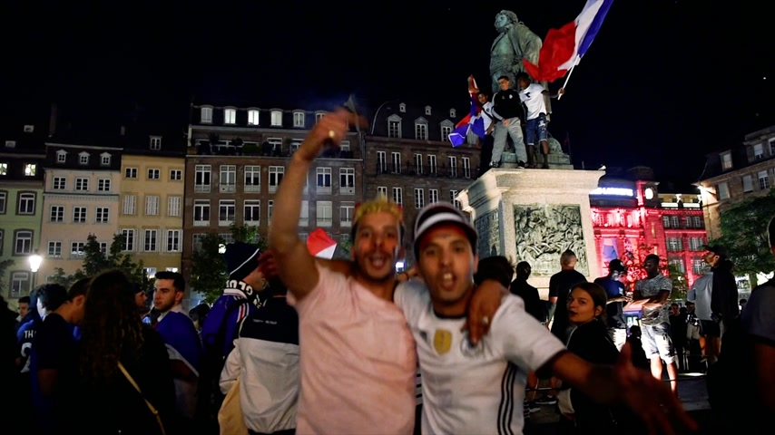 qualification round : STRASBOURG, FRANCE - JULY 10, 2018: Male couple dancing in Central Place Kleber after the victory of France qualify for the final of the 2018 FIFA World Cup after their victory over Belgium 1-0