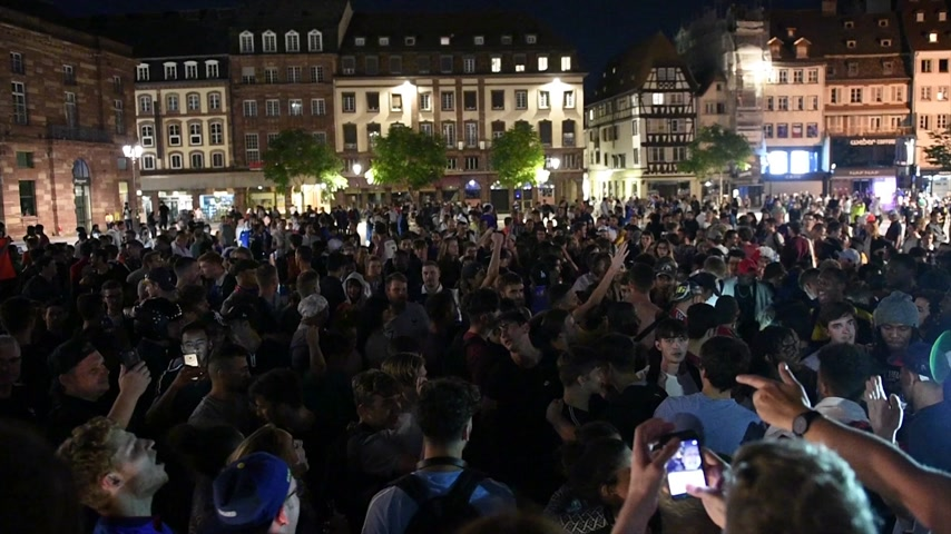 final : STRASBOURG, FRANCE - JULY 10, 2018: Crowd of fans singing La Marseillaise after the victory of France qualify for the final of the 2018 FIFA World Cup after their victory over Belgium 1-0